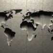 3D World Map molded into solid concrete blocked wall — Foto de Stock   #42907505