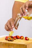 Pouring yellow palm oil — Stock Photo