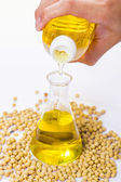 Pouring yellow soya bean oil — Stock Photo