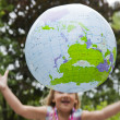 Girl throwing an earth globe — Stock Photo
