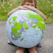 Girl holding an earth globe — Stock Photo