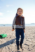 Boy jumping at beach — Stock Photo