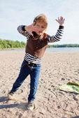 Boy playing at beach. — Stock Photo