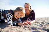 Mother and son at beach. — Stock Photo