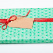 Simple gift with tag — Stock Photo #14368799