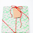 Simple gift with tag — Stock Photo #14368833