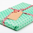 Simple gift with tag — Stock Photo #14368861