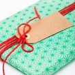 Simple gift with tag — Stock Photo