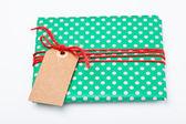 Christmas gift with tag — Stock Photo