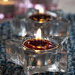 Candles on blue mat — Stock Photo