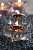 Candles on blue mat — Stockfoto