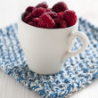 Fresh raspberries in cup — Stock Photo