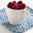 Fresh raspberries in cup — Stock Photo #14749929