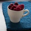 Fresh raspberries in cup — Stock Photo