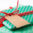 Wrapped gifts with tag - Stock Photo