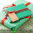 Wrapped gifts with tag — Stock Photo #14850169