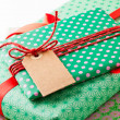 Wrapped gifts with tag — Stock Photo #14850243