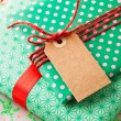 Wrapped gifts with tag — Stock Photo #14850289