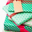 Wrapped gifts with tag — Stock Photo #14850317