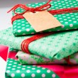 Wrapped gifts with tag — Stock Photo #14850329
