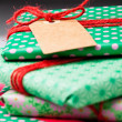 Wrapped gifts with tag — Stock Photo