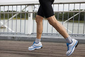 Runner in mid stride — Stock Photo