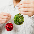 Red and green Christmas baubles — Stock Photo