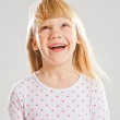 Happy young girl looking up — Stock Photo #17631515