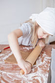 Young girl making gingerbread — Stock Photo