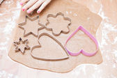 Gingerbread dough and shaped cutters — Stock Photo