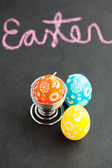 Colorful Easter egg shaped candles and text — Stock Photo