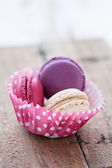 Macaroons on wooden table — Stock Photo