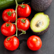Fresh tomatoes and avocados and cucumber - Stock Photo