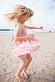 Young girl having fun at beach — Stock Photo