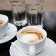 Two cups of coffee and water — Stock Photo