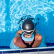 Female swimmer at pool edge — Stock Photo