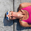 Female swimmer lying at pool edge — Stock Photo
