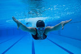 Swimming underwater — Stock Photo