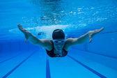 Swimming underwater — Stock Photo