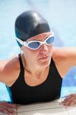 Female swimmer at pool edge — Stock Photo