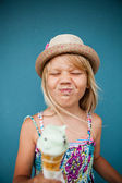 Young girl holding ice cream cone — Stock Photo