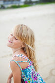 Happy cute young girl at beach — Stock Photo