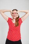 Smiling attractive woman through finger goggles — Foto de Stock