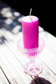 Decorative purple candle — Stock Photo