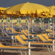 Stock Photo: Umbrellas and sunbeds