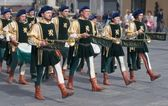 Marching medieval musicians — Stock Photo