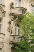 Facade of old Prague houses — Stock Photo