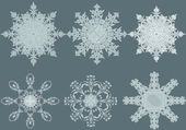 Vector stylish ornate snowflakes — Stock Vector
