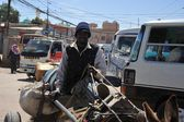 Water carrier on the street Hargeisa. — Stock Photo