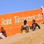 Постер, плакат: Somali boys are riding on the hill of concrete